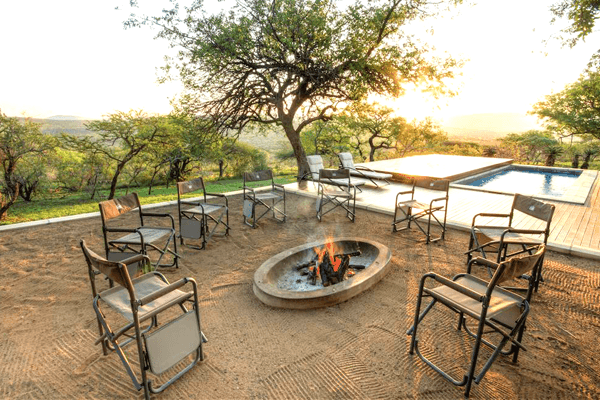 Sit around the fire at Mavela Game Lodge