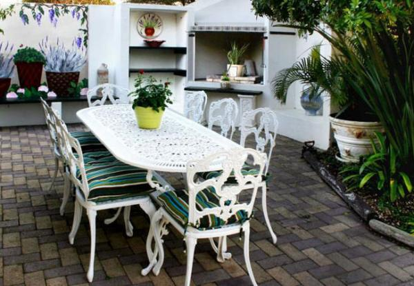 Outside table at Milkwood Country Cottage