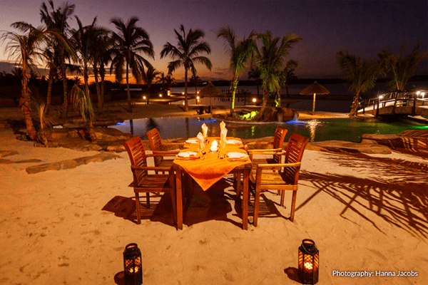 Dine on the beach at Nghunghwa Lodge in Bilene, Mozambique